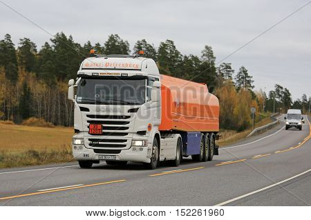 KAARINA FINLAND - OCTOBER 16 2016: New white Scania R400 semi tanker of Saint-Petersburg hauls gasoline fuel along highway in autumn.