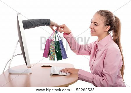 Internet Shopping and fast Delivery young Woman makes Order at Computer and Hand of Agent appears from Screen instantly completing the Deal on white Background