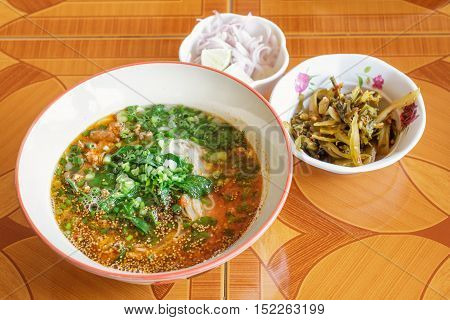 Rice noodles with soup is a noodle soup or curry of the cuisine of the Tai Yai people. Rice noodles has a characteristic spicy and tangy flavor. thai food.