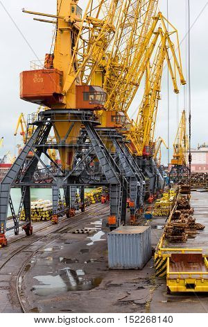 Odessa Ukraine - October 3 2016: Container cranes in cargo port terminal cargo cranes without job in an empty harbor port. A crisis. Defaulted paralyzed entire economy