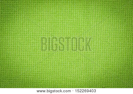 Green microfiber cloth and green microfiber texture of microfiber towel for design with copy space for text or image. Dark edged.