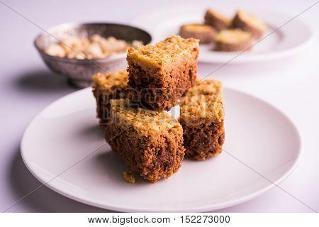 delicious indian sweet mysore pak or mysorepak served in white plate