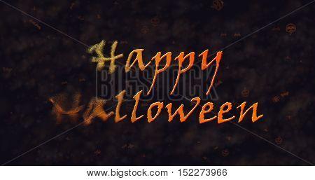 Happy Halloween text dissolving into dust to left