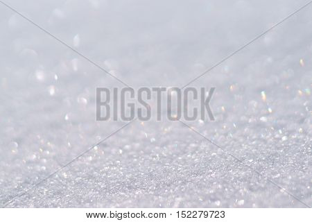 Natural bokeh winter christmas sparking snow background.
