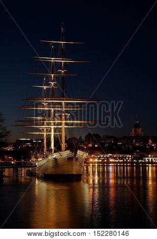 Stockholm, Sweden - November 9, 2012: Chapman sailing ship in the light of dawn at Skeppsholmen now a youth hostel.