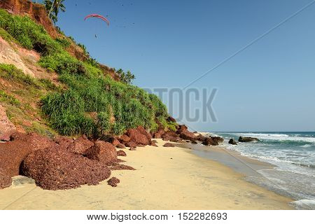 Beautiful orange cliffs in Indian - Kerala beach