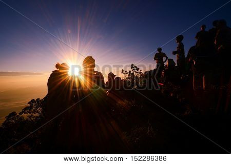 sunrise at mountain with silhouette people and couple success to climbing victory celebration at Doi Luang Chiang Mai Thailand.