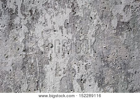 Decorative background for design from the texture of the concrete surface with different size and shape of cracks and holes
