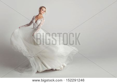 Beautiful bride in wedding dress, white background