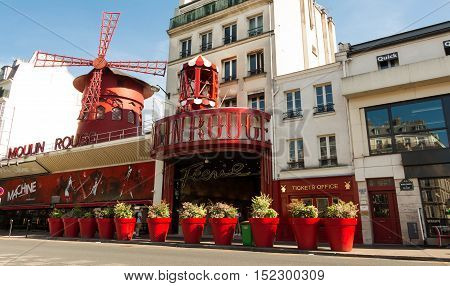 Paris France-July 09 2016: The famous cabaret Moulin Rouge located in picturesque Montmartre district of Paris.