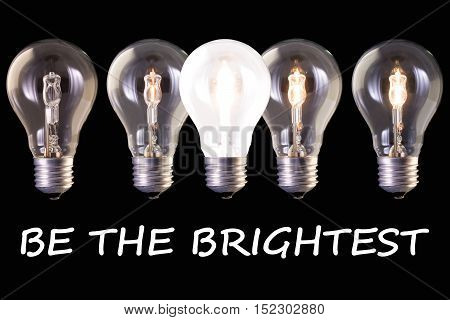 concept idea be the brightest five lamp bulb halogen with different luminosity against black background