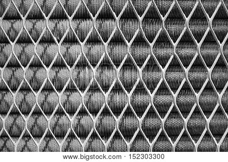 Abstract engine cooling motor with steel wire net on black and white tone for background texture.
