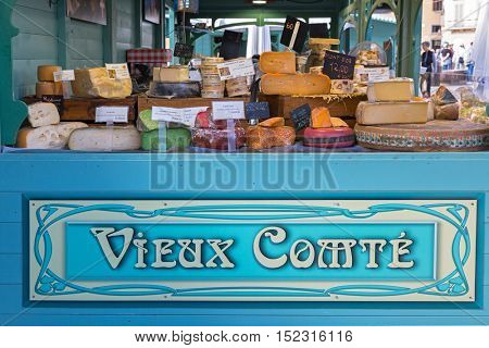 FLORENCE, ITALY - SEPTEMBER 2016 : Different type of cheese sold at Vieux Comte booth at Piazza di Santa Maria Novella, outdoor market in Florence, Italy on September 21, 2016.