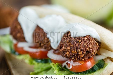 Wooden Table With Falafel Sandwich