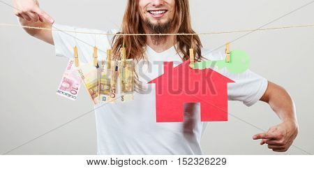 Man Seller With Money And House