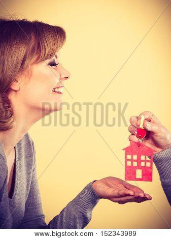 Male Hand Giving Woman House Key