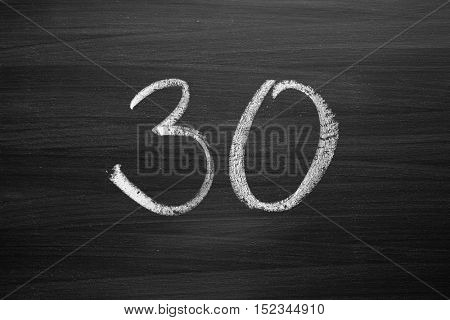 number thirty enumeration written with a chalk on the blackboard