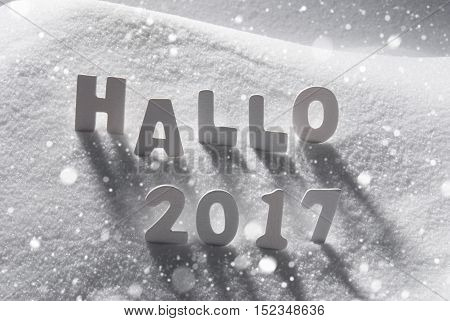 White Letters Building German Text Hallo 2017 Means Hello 2017 In Snow. Snowy Scenery With Snowflakes For Happy New Year Greetings.
