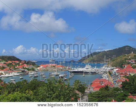 ST BARTS, FRENCH WEST INDIES - JANUARY 19, 2005: Aerial view at Gustavia Harbor with mega yachts at St Barts. The island is popular tourist destination during the winter holiday season