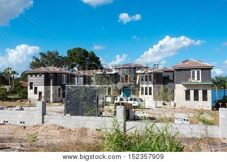Large multiple level block home construction with Grand door entrance
