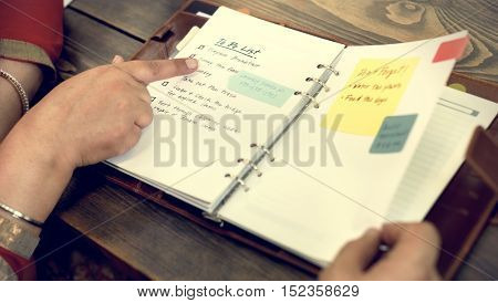 Indian Couple Checking To Do List Concept