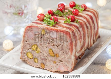 Delicious terrine with ground meat, ham and pistachios for Christmas poster