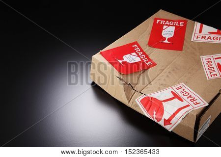 damaged cardboard box with fragile sticker