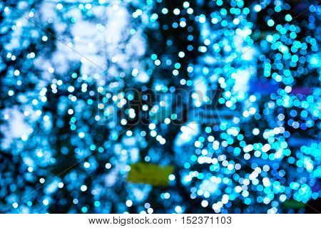 Holiday blur abstract. White and blue illumination off focus background.