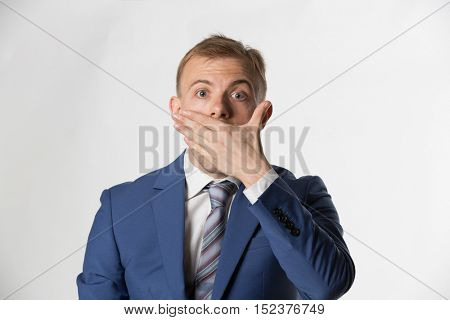 Shocked Businessman covering his mouth