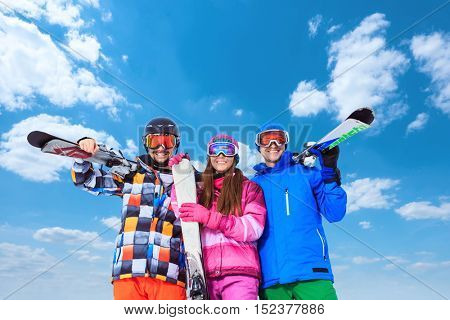 Active people with skis outdoors