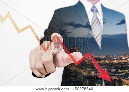 Businessman pointing finger to screen with a falling dow to bottom arrow graph, representing business decrease