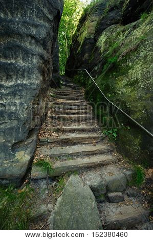 Stairs on the trail of the rocks and woods
