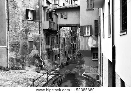 Canal in the old town of Bologna, Italy. Black and white image