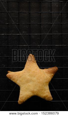 Single Star Shaped Biscuit On Cooling Rack