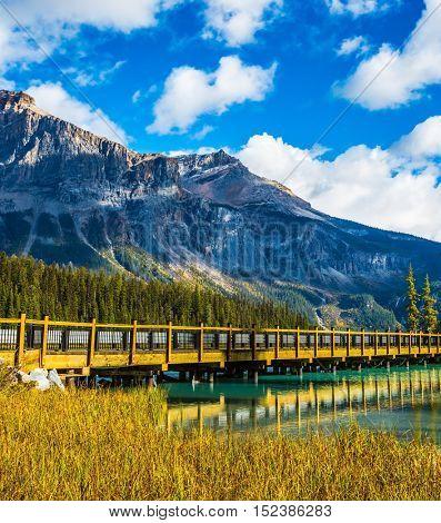 Yoho National Park, Rocky Mountains, British Columbia. Wooden bridge over Emerald Lake