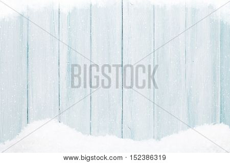 Blue wooden wall texture with snow christmas background