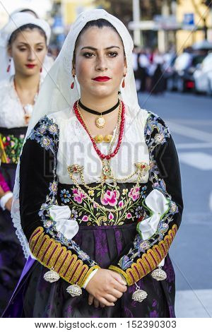 QUARTU S.E., ITALY - September 17, 2016: Parade of Sardinian costumes and floats for the grape festival in honor of the celebration of St. Helena. - Sardinia - Folk group Santa Rughe from Uri