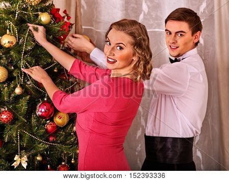 Couple on party near Christmas tree. Love and romantic Christmas.