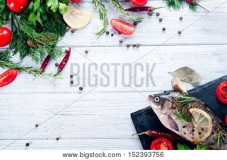 Delicious Fresh Fish On White Vintage Background.