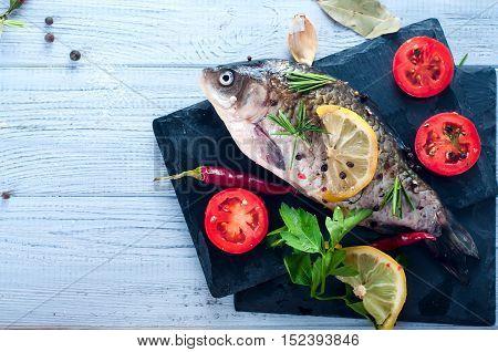 Delicious Fresh Fish On White Vintage Background.