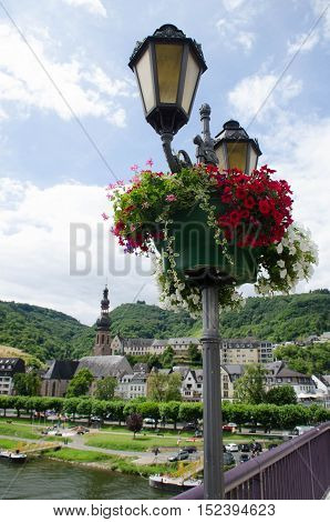 Street lights with red and white flowers in Cochem