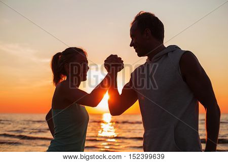 Couple showing their strength by shaking hands