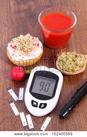 Glucose meter with accessories for checking and measuring sugar level freshly vegetarian sandwich with cottage cheese and vegetables diabetes healthy lifestyle and nutrition