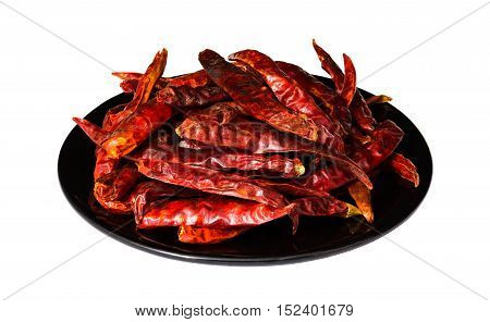 Dry chili on black dish with white background and clipping path