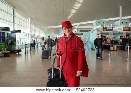 BARCELONA, SPAIN - CIRCA NOVEMBER, 2015: a flight crew member at Barcelona Airport. Barcelona-El Prat Airport is an international airport. It is the main airport of Catalonia, Spain.