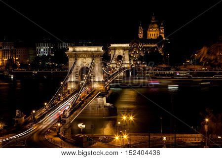Chain Bridge crossing the Danube withSt. Stephen's Basilica in the background illuminated at night Budapest Hungary - 23 Sep 2016