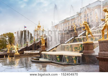 PETERHOF, SAINT PETERSBURG, RUSSIA - OСTOBER 09, 2016: Grand Cascade Fountains at Peterhof, near St. Petersburg. Fountains of Peterhof are one of Russia's most famous tourist attractions