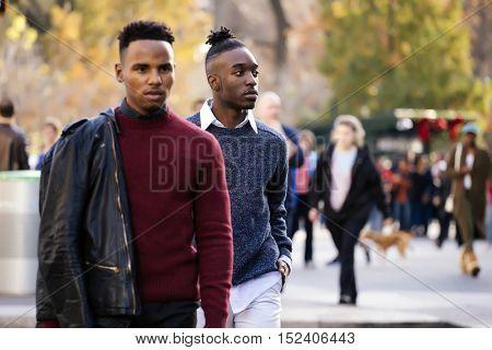 Two man walking on the street in winter. Street fashion in NY.
