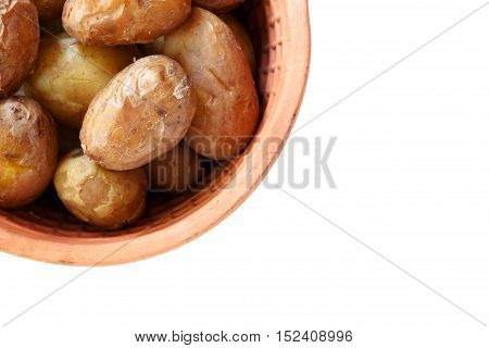 Young baked tasty potatoes in clay pot on white background