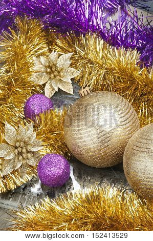 Colorful and vivid Christmas still life. Close Up view of Christmas golden balls with sparkles and decorative tapes.